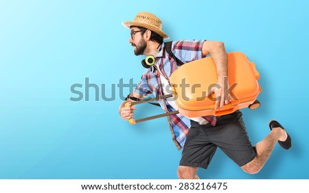 Tourist running fast over colorful background - stock photo