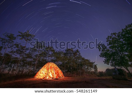 tourist's tent Beautiful scenery of the startrail on sky at night at Udon Thani in Thailand.