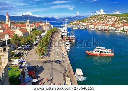 Tourist ship enters the harbor of old town of Trogir, Croatia - stock photo