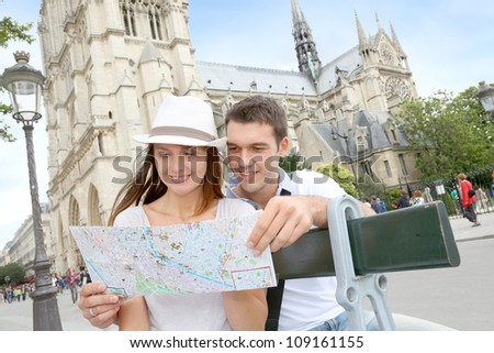 Tourist sitting in front of Notre Dame of Paris Cathedral - stock photo