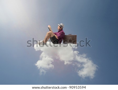 Tourist sitting on a cloud and reading a book - stock photo