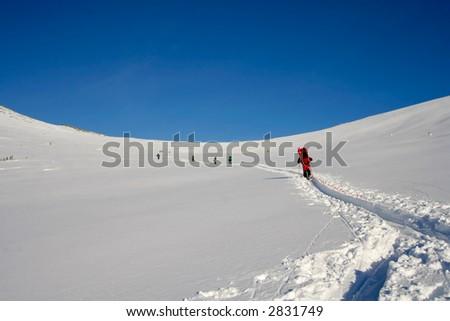 Tourist ski team climbing an crosspass in Sayani, Russia - stock photo