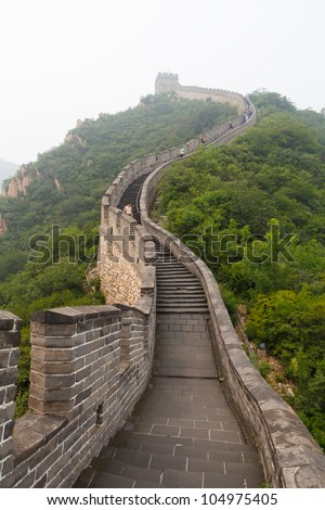 Tourist-spot at Great Wall of China under the fog - stock photo