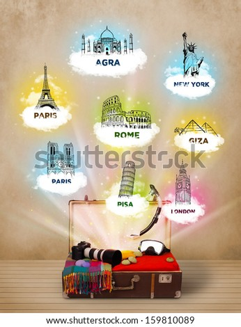 Tourist suitcase with famous landmarks around the world on grungy background - stock photo