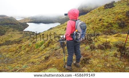 Tourist taking a photo in the Cayambe Coca National Park