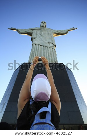 tourist taking a picture of the corcovado christ redeemer in rio de janeiro brazil - stock photo