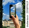 Tourist taking a picture with mobile phone of Rodin's Museum - stock photo