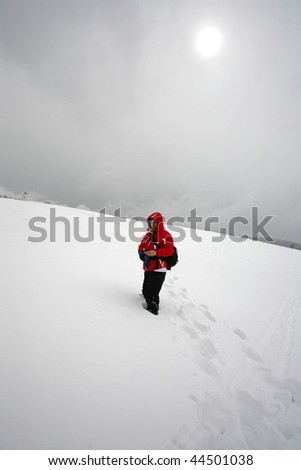 tourist taking a walk in high mountain - stock photo
