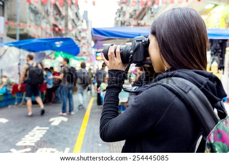 Tourist taking photo with camera - stock photo