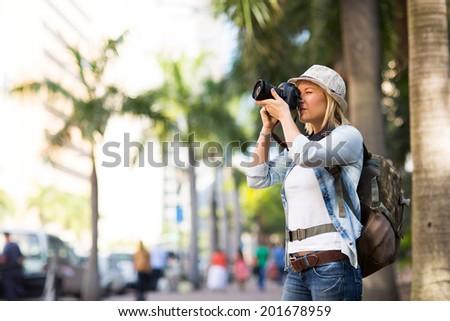 tourist taking photos in the urban city - stock photo