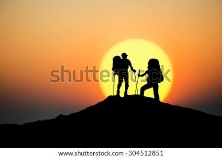 Tourist team on mountain peak. Sport and active life concept - stock photo