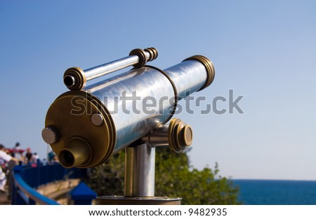 Tourist telescope at sea coast.