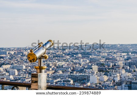 Tourist telescope in the Eiffel tower for view the city of Paris - stock photo