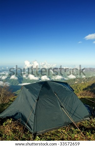tourist tent in a mountains - stock photo
