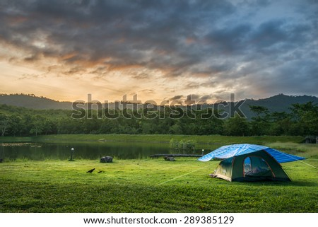 Tourist tent in camp among meadow in the National park - stock photo