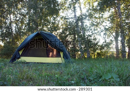 Tourist  tent in wilderness - stock photo