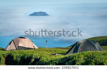Tourist tents in the  mountains, Paramushir Island, Kuril Islands, Russia - stock photo