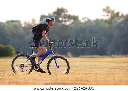 Tourist traveling by bike in the summer. - stock photo