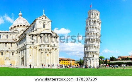 Tourist visiting the leaning tower of Pisa , Italy  - stock photo