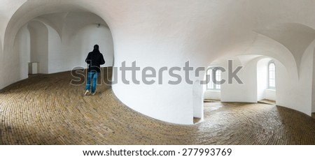 Tourist Walking in Rundetaarn, Copenhagen, Denmark - stock photo