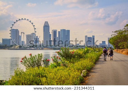 Tourist Walking On The Way For Sightseeing In Singapore City - stock photo