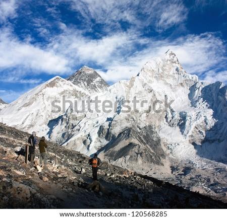 tourist watching Mount Everest from Kala Patthar view point - Nepal - stock photo