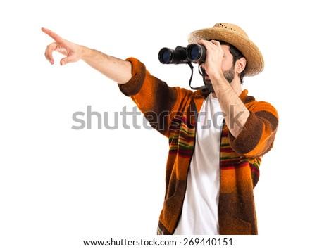 Tourist with binoculars over white background   - stock photo