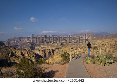 Tourist with Camera in Fish Creek Canyon, Arizona. - stock photo