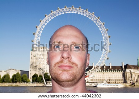 tourist with london eye around his head like a halo or glory. tourist attraction in capital of great britain or england and white male - stock photo