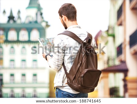 Tourist with map in the city - stock photo