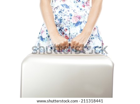 Tourist woman holding suitcase isolated white - stock photo