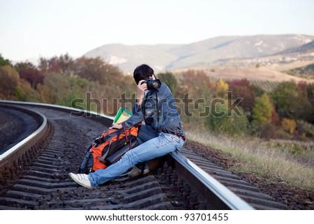 Tourist woman on the railway - stock photo