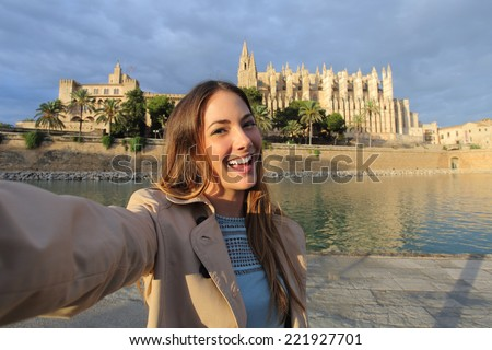 Tourist woman photographing a selfie in Palma de Mallorca Cathedral on holidays - stock photo