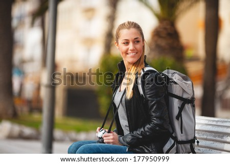 Tourist woman sited taking pictures - stock photo