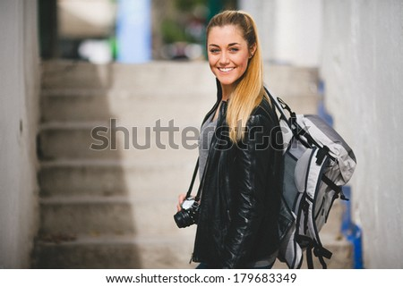 Tourist woman walking arround the city