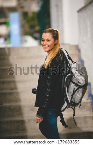 Tourist woman walking arround the city - stock photo