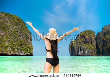Tourist women happy Have come to Koh Phi Phi, Maya Bay in the summer of Thailand - stock photo