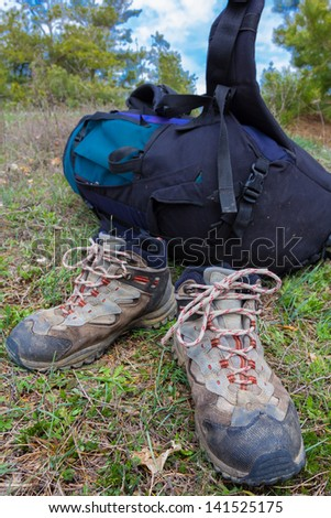 touristic backpack and books - stock photo
