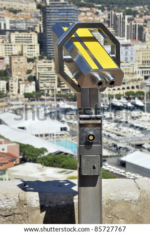 Touristic binocular in yellow. Optical instrument to magnify panoramic views