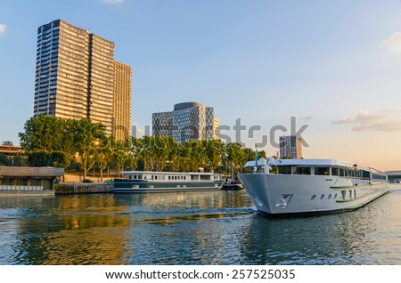 Touristic boat sailing in the river Seine, Paris, France - stock photo
