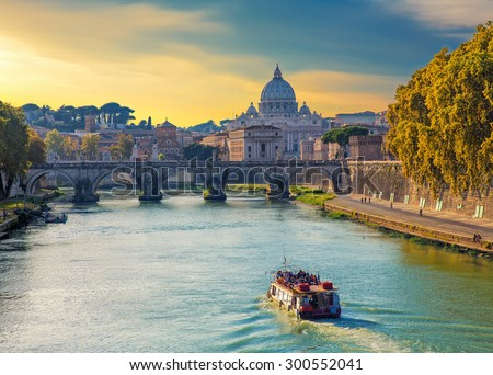 Touristic boat sailing on Tiber river at evening, with Saint Peters basilica on the background. Roma. Italy. - stock photo