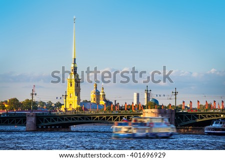 Touristic boats with people going down the Neva river in front of Peter and Paul fortress and Palace bridge in Saint Petersburg, Russia. Summer day with cloudy blue sky - stock photo