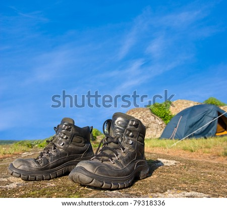 touristic boots near a touristic camp - stock photo