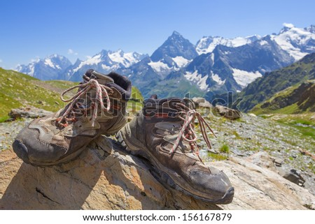 touristic boots on a mountain chain background - stock photo