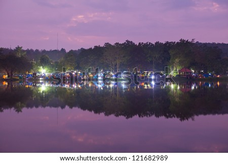 touristic camp at the evening by the lake - stock photo
