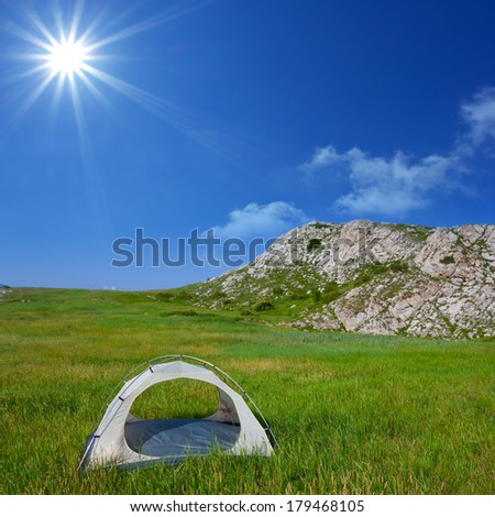touristic camp in a green grass - stock photo