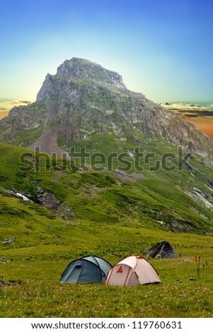 touristic camp near a mount foot - stock photo