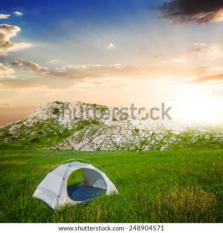 touristic camp near mountain footprint - stock photo