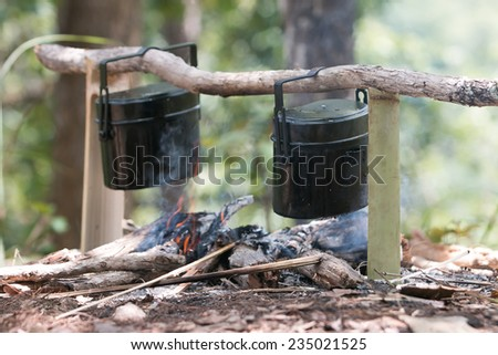 touristic cauldron in a camp fire - stock photo