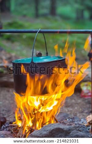 touristic cauldron in a fire - stock photo